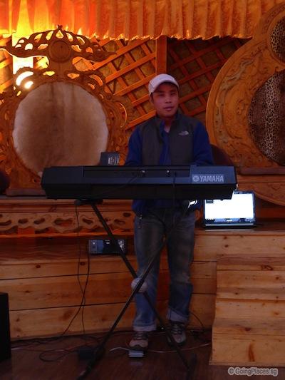 Leong Playing Electronic Organ