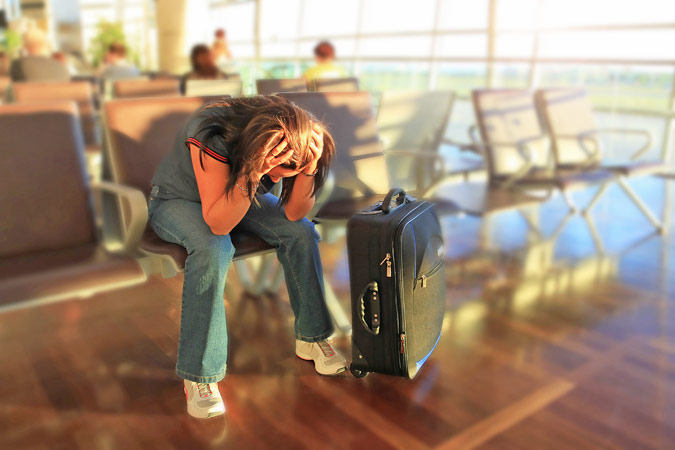 Delayed flight depressed woman