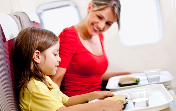 Young girl enjoying airline food
