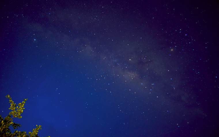 The Milky Way and shooting star captured just before dawn at Tunamaya Resort, Tioman Island